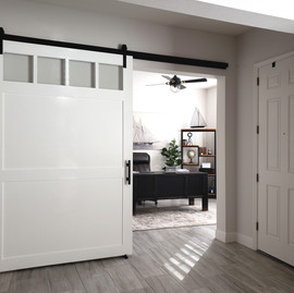 classic white barn door with glass