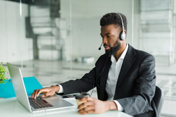 african-american-man-customer-support-operator-with-hands-free-headset-working-office_2312