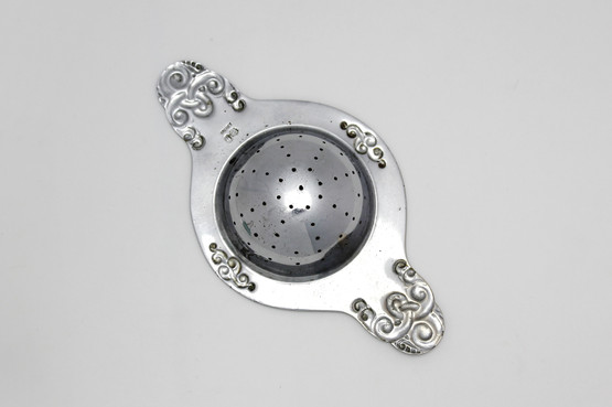danish art nouveau skønvirke silverplated tea strainer double handle scroll viking motif antique tang seaweed