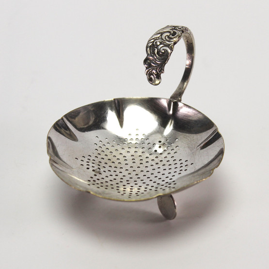 english england silverplated epns tea strainer stand three footed handle floral design