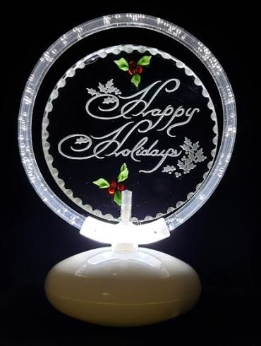 HALO illuminated with hand carved holly and Happy Holidays