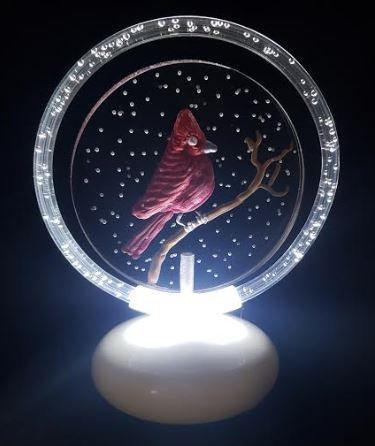 Cardinal in snow illuminated halo