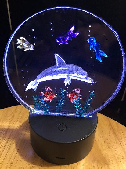 Dolphin scene on battery light