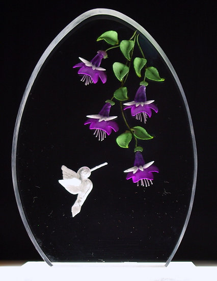 Hummingbird and fuschia flowers