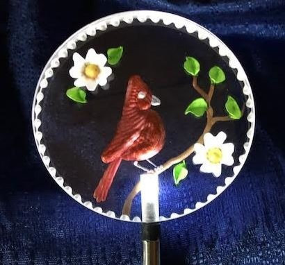Cardinal with dogwood flowers Lighted solar stake