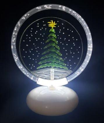 Evergreen in snow illuminated halo