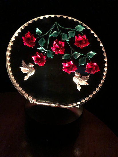 Hummingbirds amoung roses on battery light