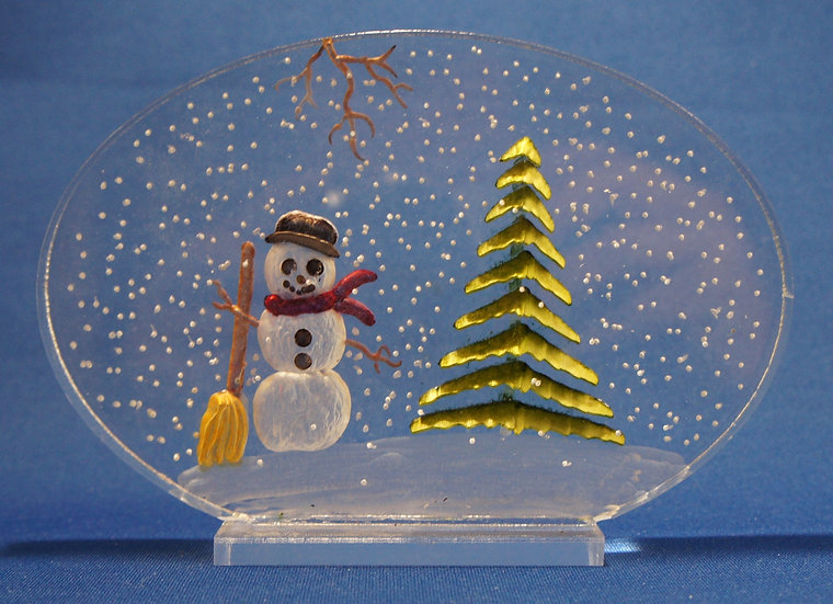 Snowman and evergreen  tree