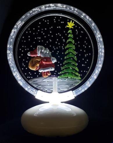 Santa and evergreen in snow illuminated halo