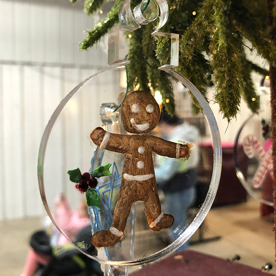 Gingerbread man with holly ornament