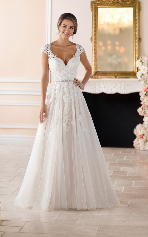 8441f4acec This gorgeous lace wedding gown is available in plus sizes.