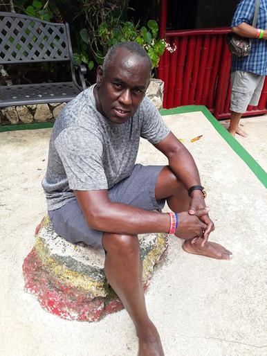 Sitting on Marley's rock, Nine Mile, Jamaica.