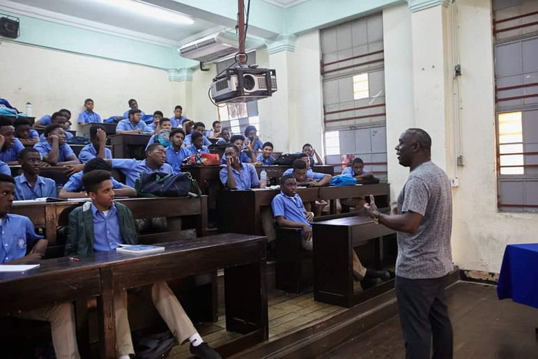 Addressing students in Port of Spain, Trinidad.
