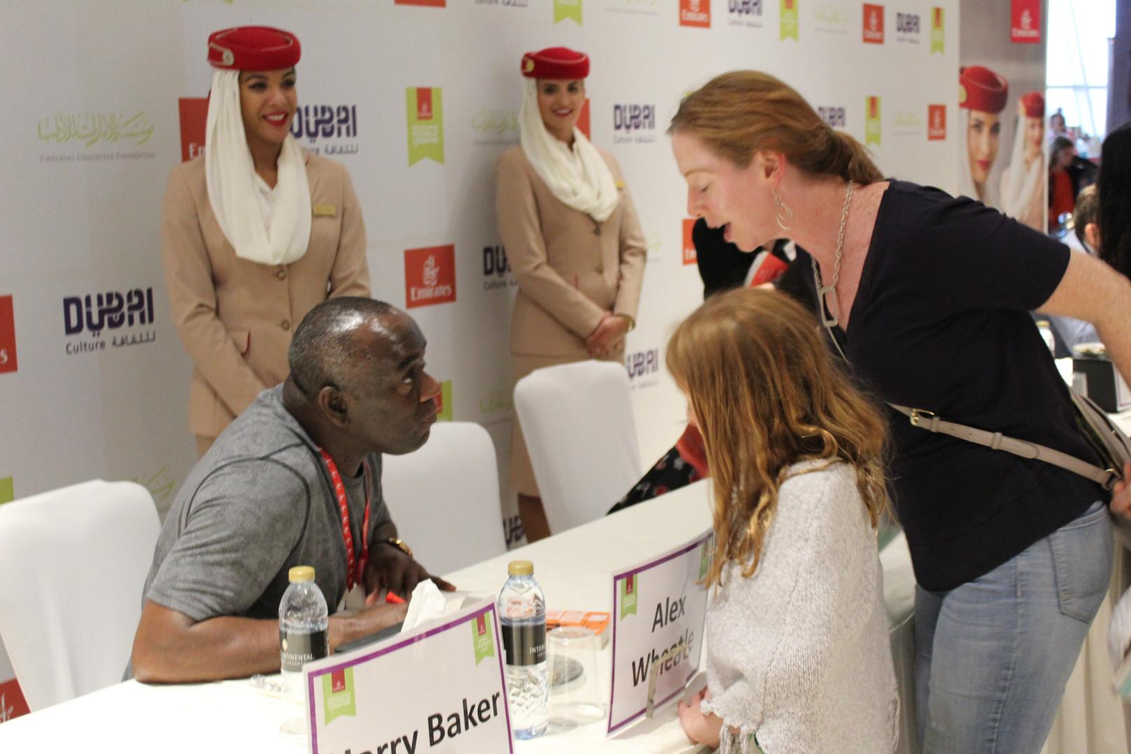 Signing books in Dubai.
