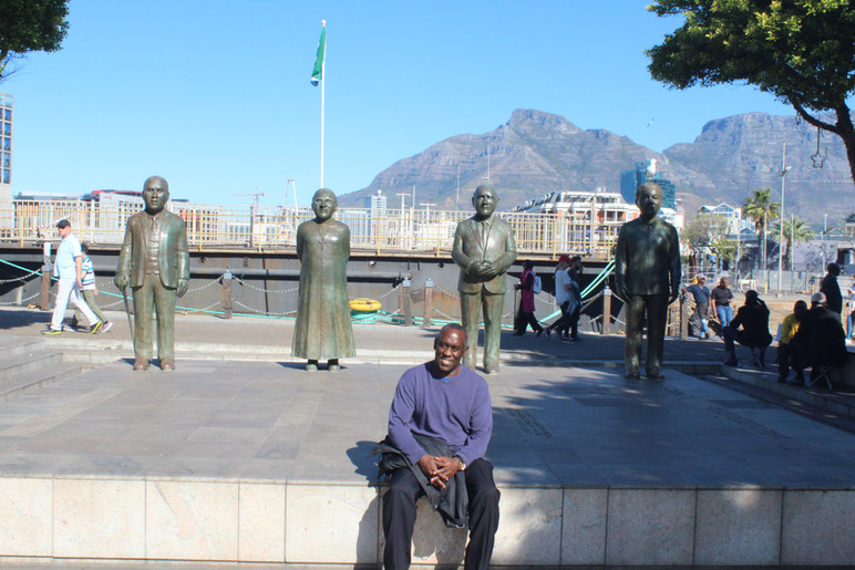 Backdropped by statues of South African heroes, Cape Town, South Africa.