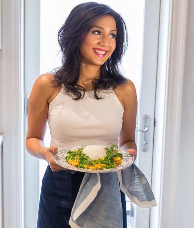 Dalia David Holding A Plate