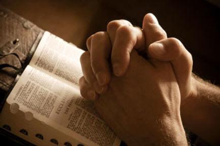 Praying-Hands-over-Bible.jpg