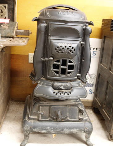 Since there were no furnaces to keep you warm in winter, they used this type of wood burning stoves in homes and schools. They would keep a fire going by burning wood in the stove.