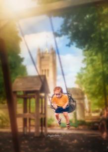 bobo on swing.JPG