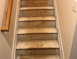 Old stair pine before to install new hardwood covered
