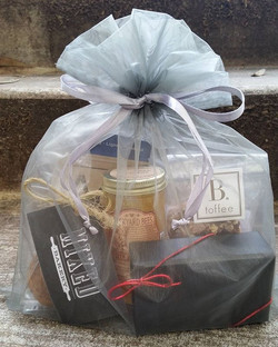 Organza pouch with curated artisan products #supportlocal #artisanal #btoffee #backyardbees #mixedba