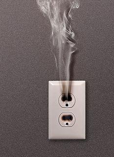 white household socket has burned from short circuit.jpg