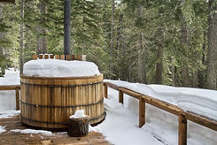 Nice wooden hot tub covered with snow.jpeg