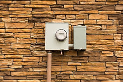 Smart Electric Utility Meter mounted on Natural Stone Wall..jpg