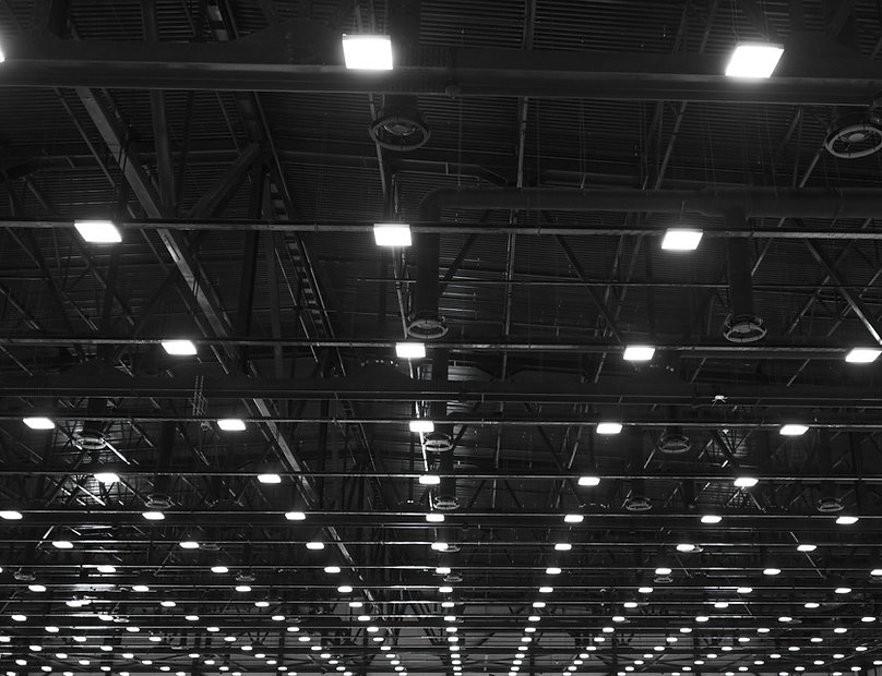 Lights and ventilation system in long line on ceiling of the dark office industrial buildi