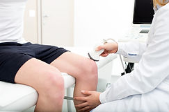 Female doctor visiting her male patient