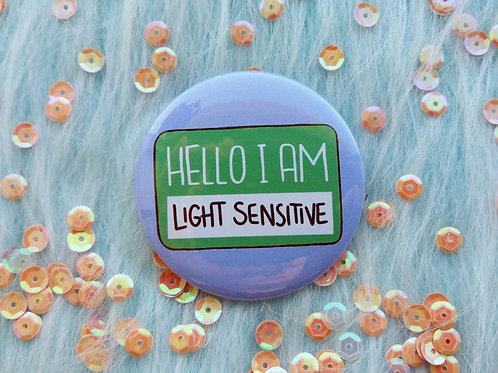 Hello I am light sensitive badge, photophobia pins