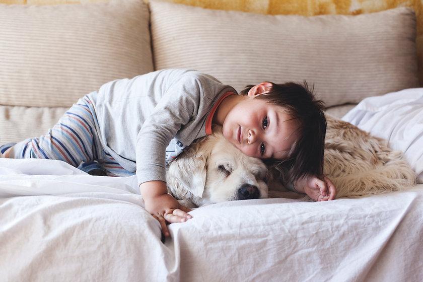 Boy Cuddling with his Puppy