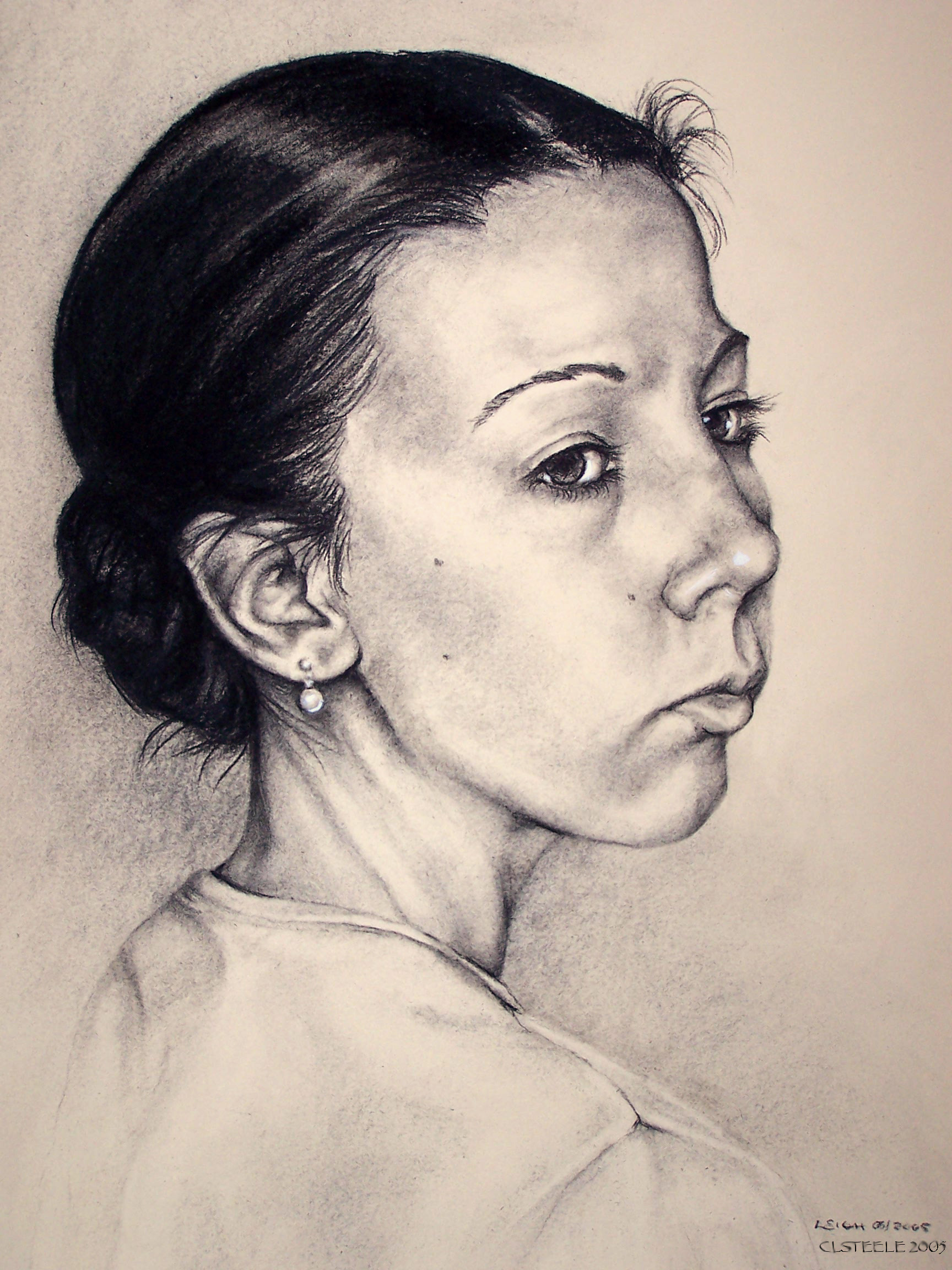 Portrait of a young woman looking over her shoulder, rendered in charcoal on off white paper