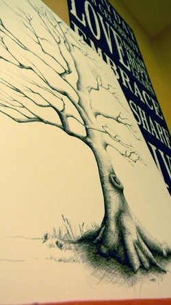 Drawing of a tree with no leaves with bride and groom name at the bottom in pen and ink