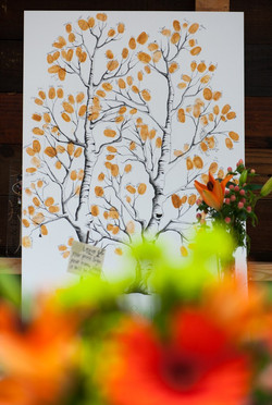 Photograph of the Wedding Tree Guestbook at Wedding full of thumprint leaves
