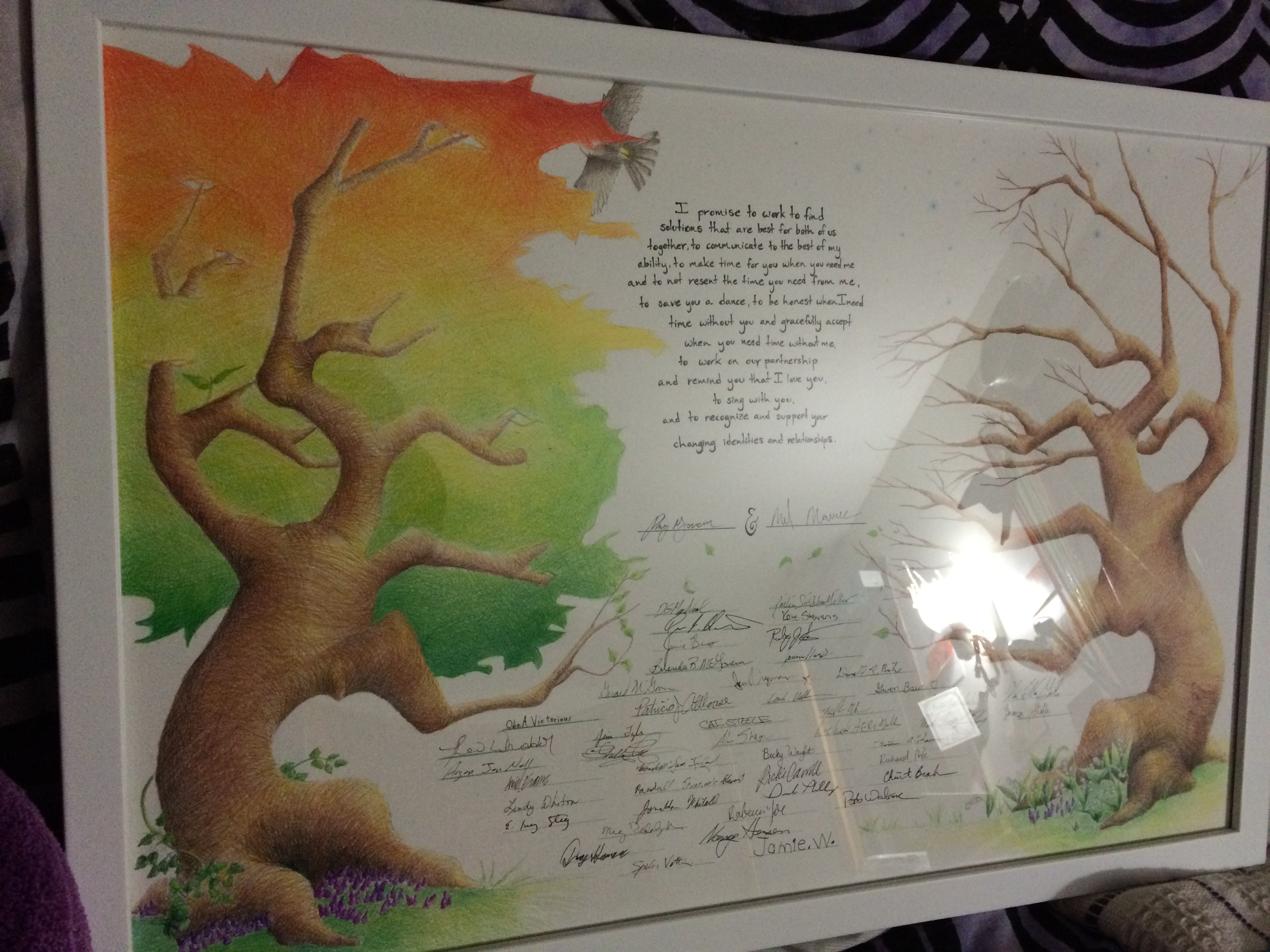 Drawing of two trees one full of leaves, the other bare with wedding vows and guest signatures in be