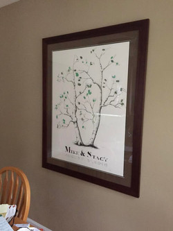 Photograph of Wedding Tree Guestbook hanging on a wall