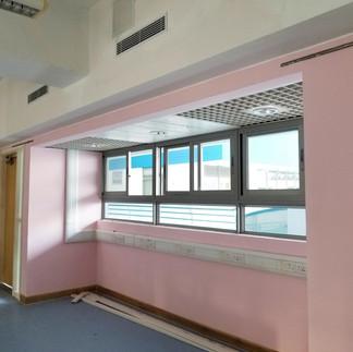 Repaint ceiling and replace vinyl floor  Replace classroom's door