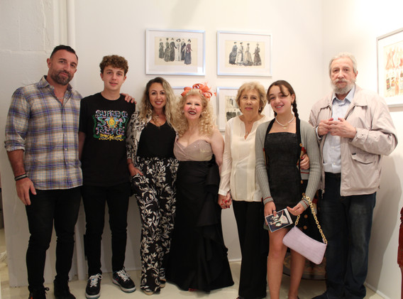 Michael Gleizer & family raise a glass of pink champagne with Ms. Ruthie Tucker, owner, Amsterdam Whitney Gallery