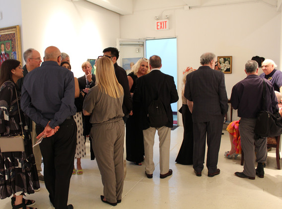 """Guests saluting the """"Mid-Summer Night's Dream"""" spirit at Amsterdam Whitney Gallery"""