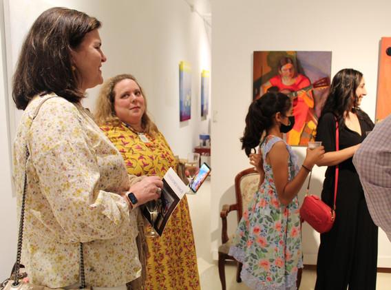Dora Savignac explains her portraits to Amsterdam Whitney Gallery collectors