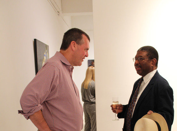 Toasting the Chelsea Art Season is Michael Breslin, Esq., Attorney-at-Law, Managing Director, The Fulserv Group & the Honorable Herman Amos Jr., US Department of Justice