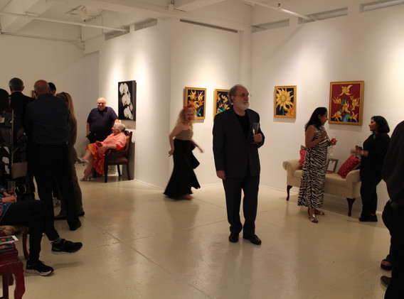 John Peters raises a glass of pink champagne to toast the Chelsea Art Season