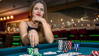 beautiful-woman-casino-taking-chips-from