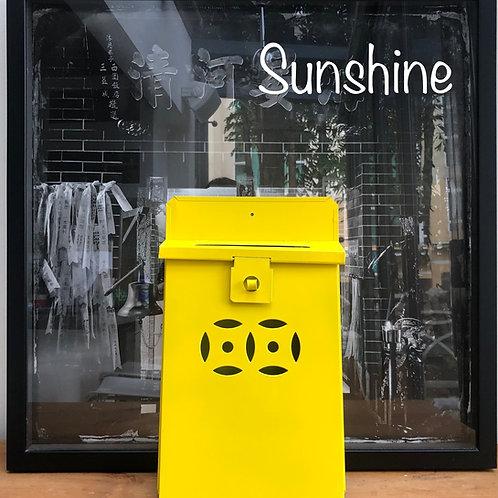 Sunshine yellow letterbox