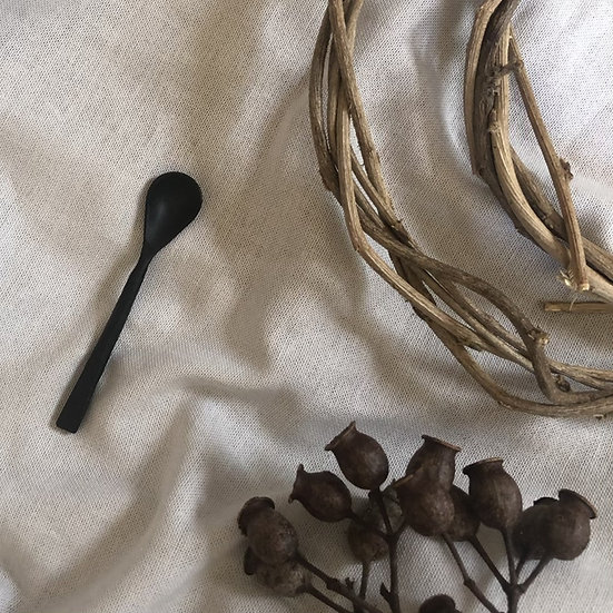 Black rustic hammered iron spoon
