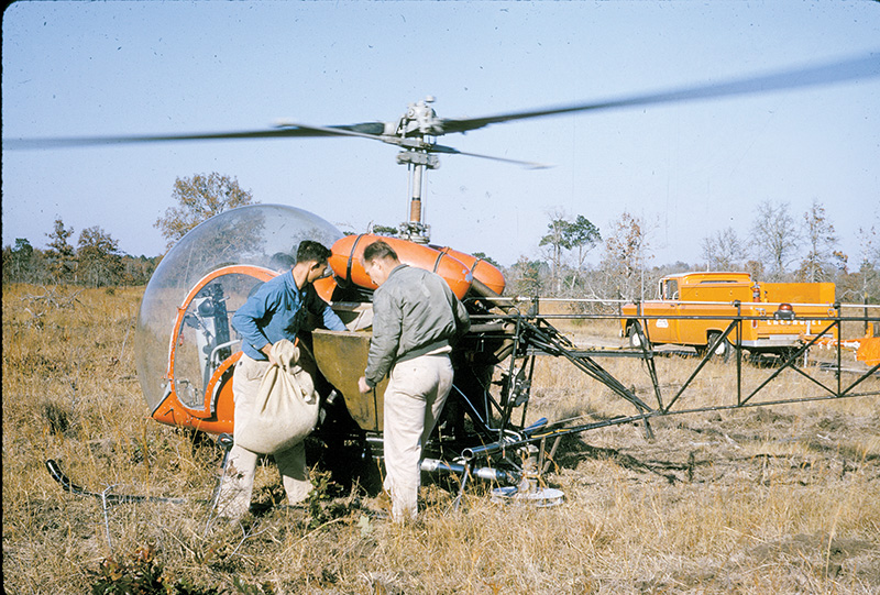 SD_Loading helicopter with treated seeds