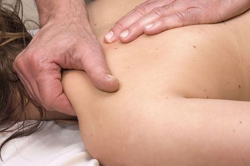 Woman having deep tissue massage.jpg