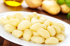 homemade gnocchi di patate served on a p
