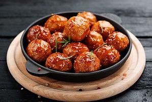 Chicken Meatballs with glaze on black wooden  background. .jpg